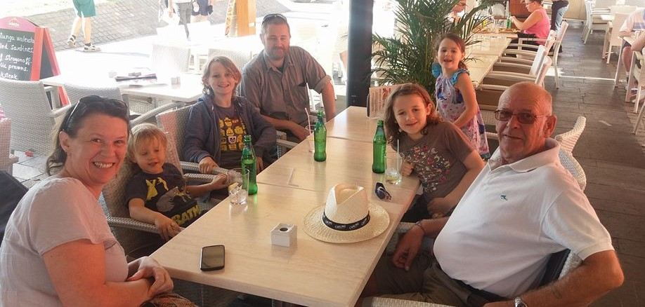 Family coffee break at a beachfront cafe in Los Cristianos