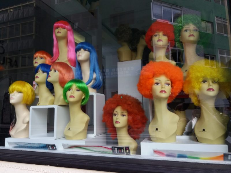 Colourful wigs in window for Las Palmas Carnival