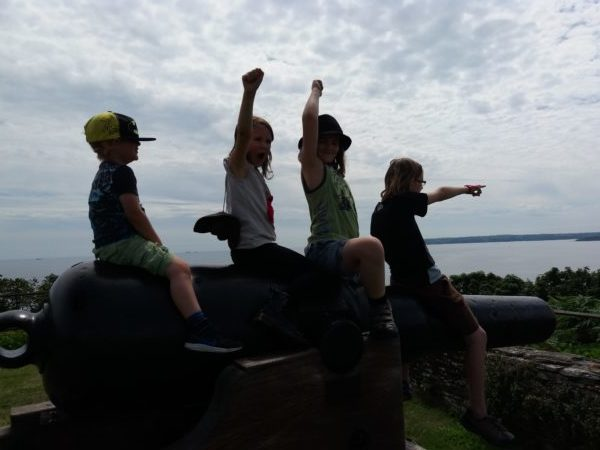 Children sitting on cannon at Pendennis Castle